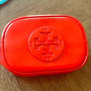 Used Tory Burch makeup bag. Red patent leather.